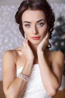 beautiful elegant bride with dark hair posing at studio