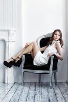 young beautiful woman in white short dress photo