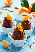 Chocolate cupcakes with orange and chocolate. photo