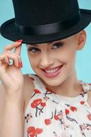 Beautiful young woman with extravagant black cap