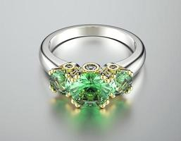 Ring with Emerald. Jewelry background photo