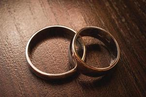 Wedding rings on wooden background