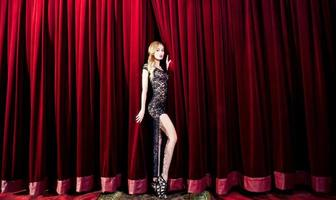 Beauty blonde woman on the stage photo