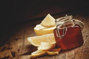 Honey with lemon, herbal medicine and healthy food concept