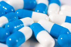 Background of blue and white capsule pills photo