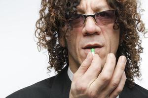 Man taking pill