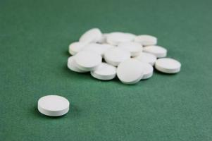 white tablets on a green background photo