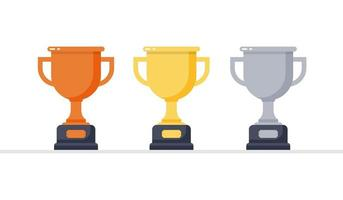 Gold, silver and bronze trophies vector