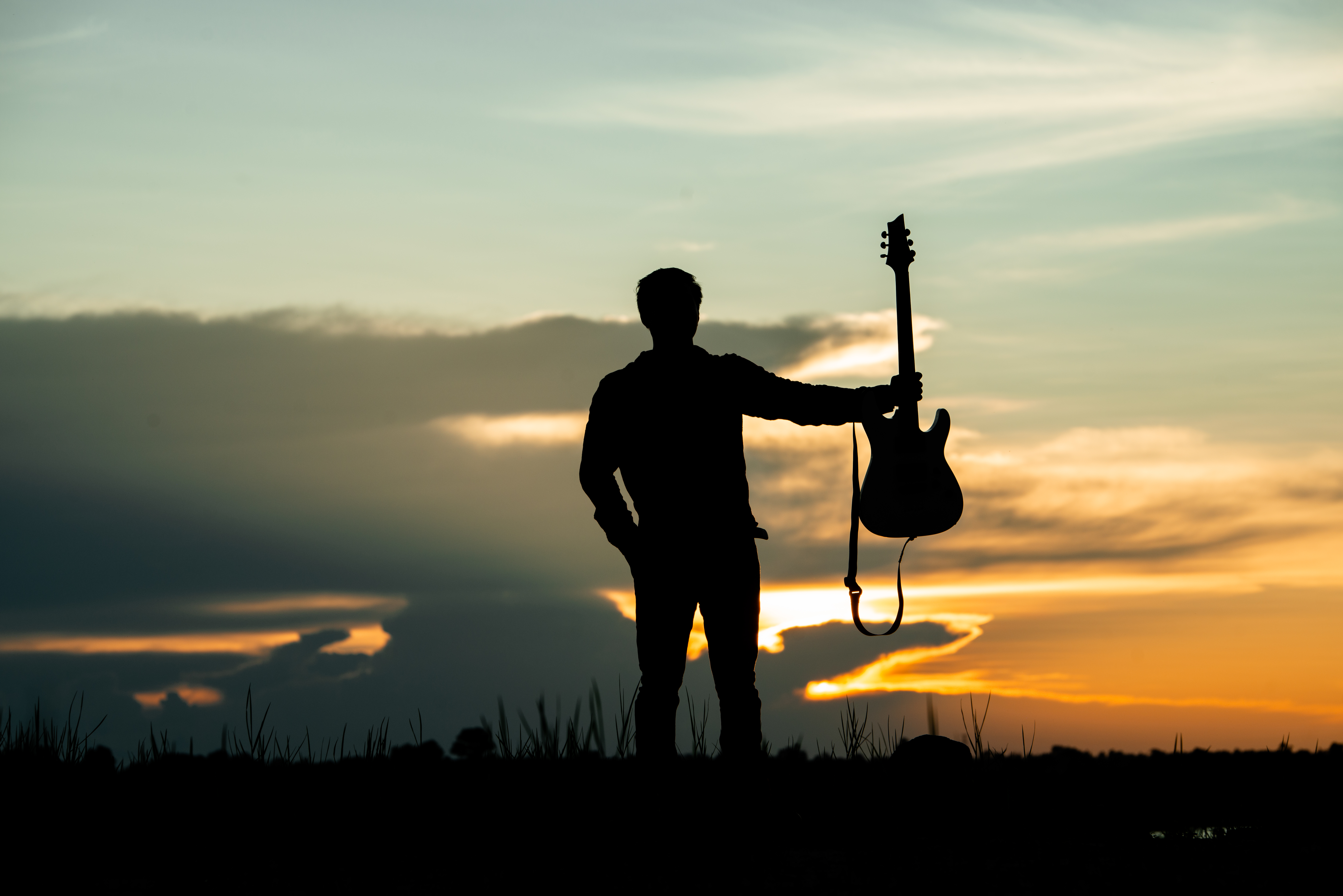 Silhouette of musician with guitar