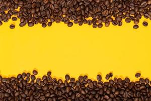Coffee beans on yellow background
