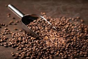 Coffee background. Roasted Coffee beans and scoop