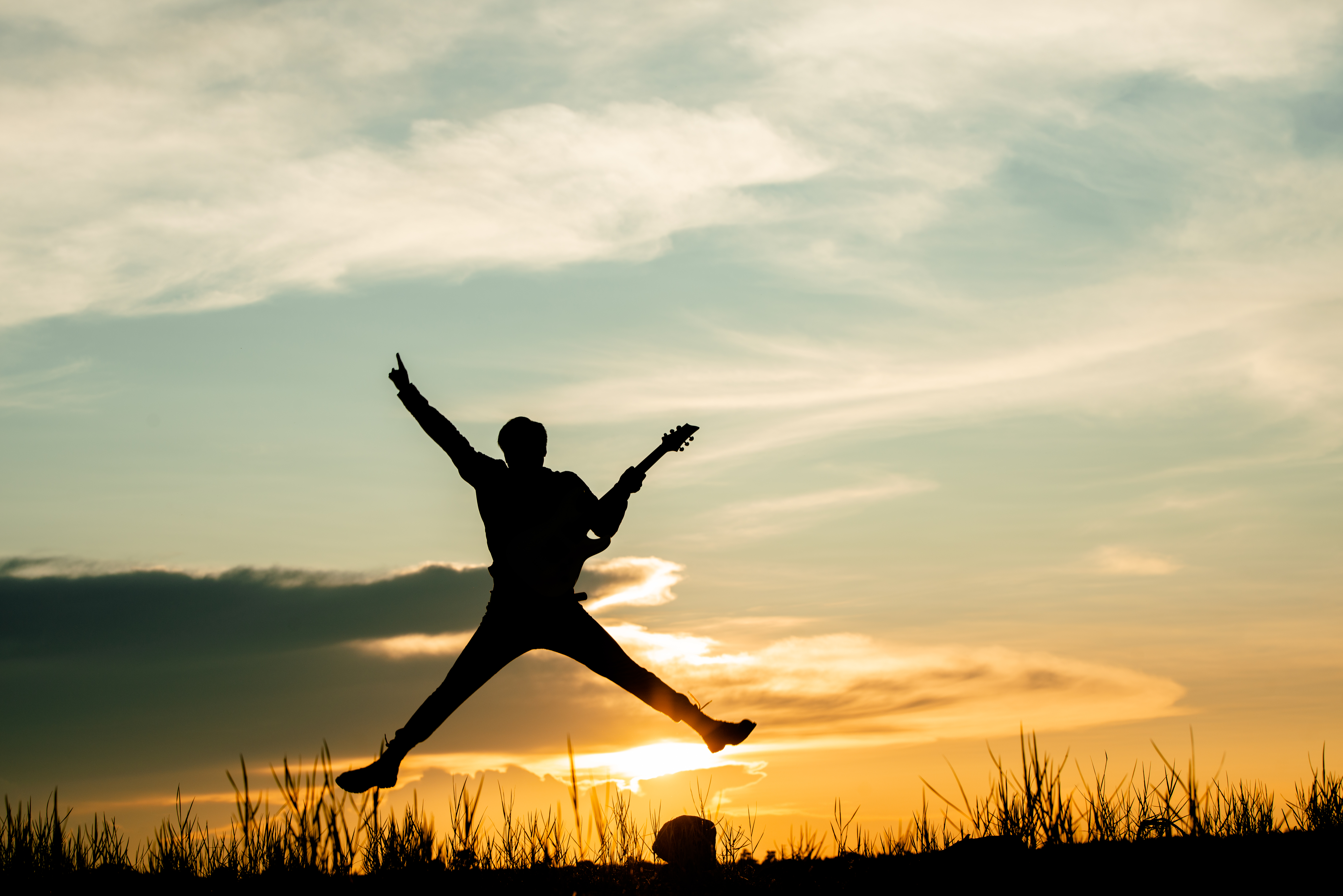 Musician man jumps while playing
