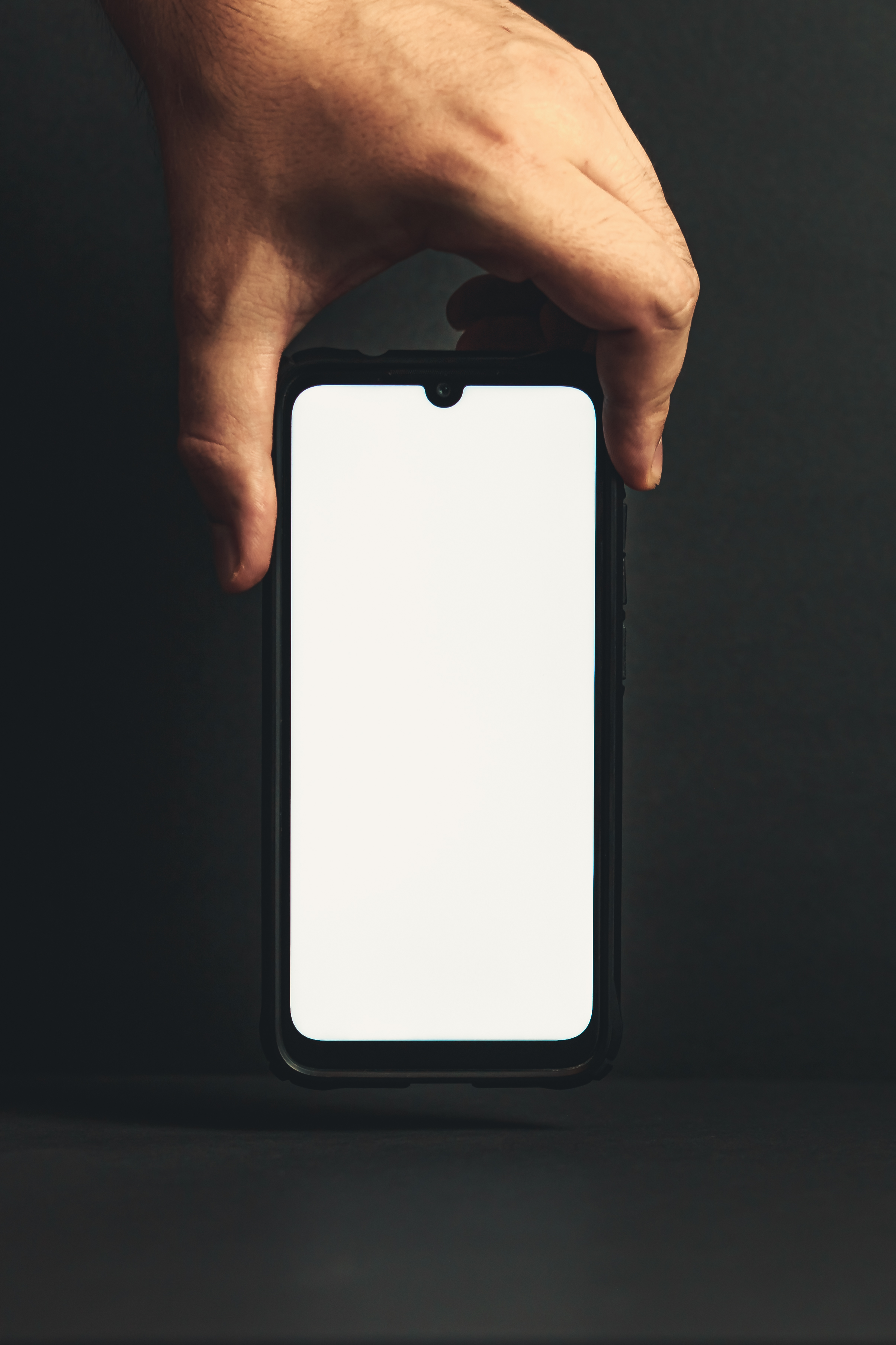 Hand grabbing a blank phone from the top