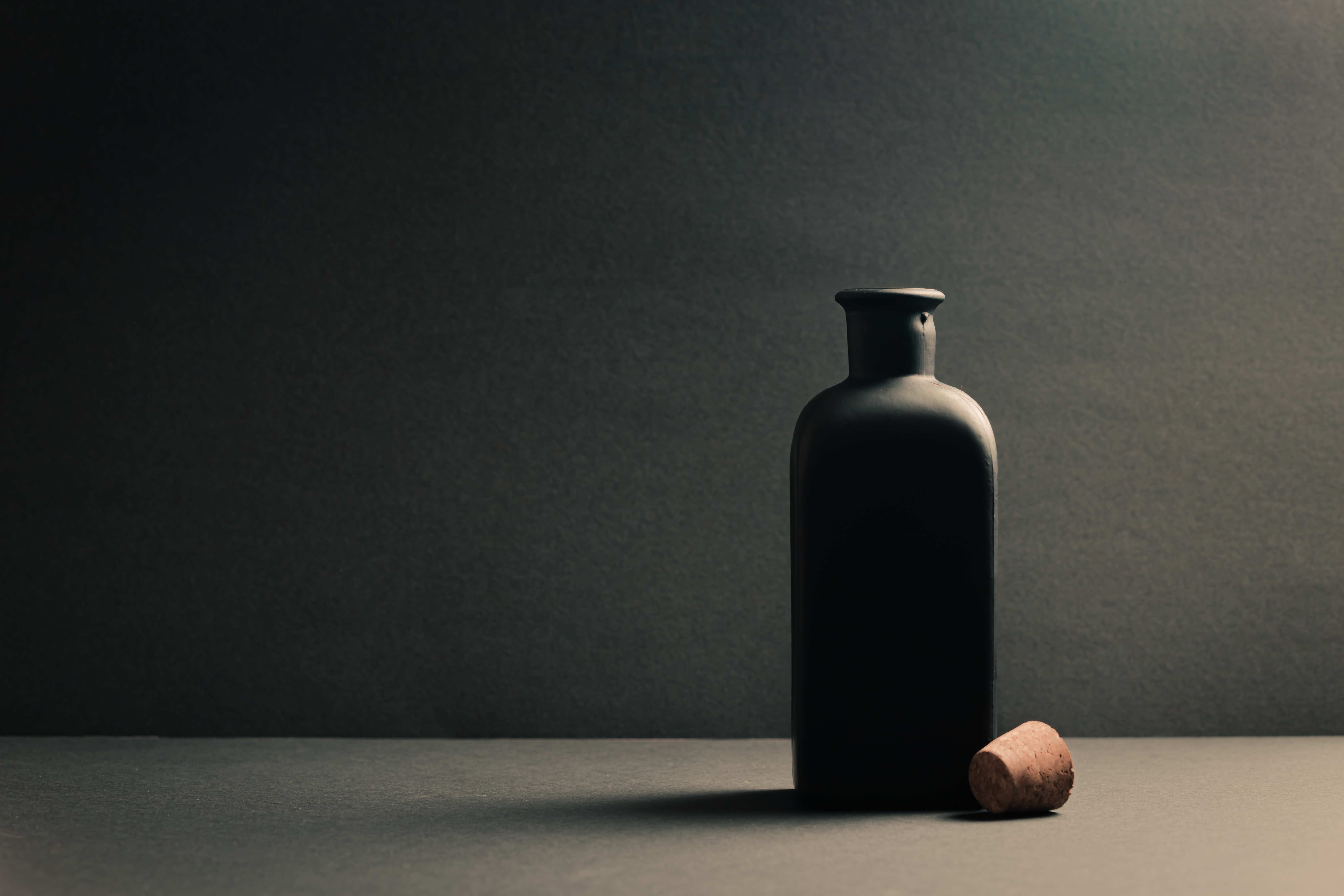 Single black ceramic bottle