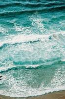 Aerial view of waves over the sand  photo