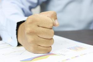 Man placing fist on paperwork