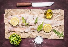 raw cod lemon herbs, salt butter  background top view