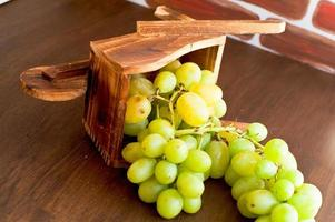 cluster of grapes in a wooden cart photo