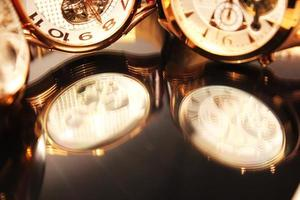 Black glass reflection of golden chronometers
