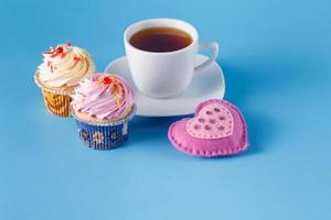 Heart symbol with cupcakes and tea