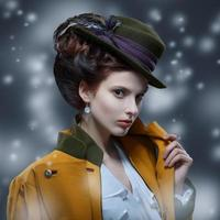 Portrait of elegant girl in a hat with a feather