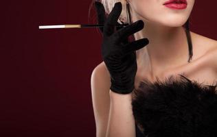 elegant Beautiful blonde lady with black feather fan. studio portrait