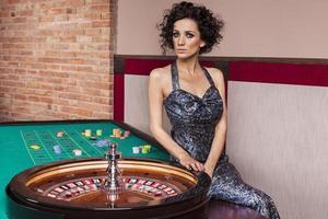 Dark hair elegant woman in casino
