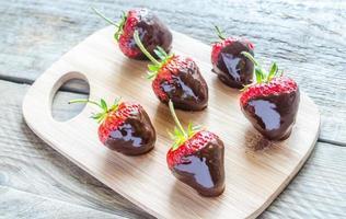 Fresh strawberries covered with dark chocolate photo