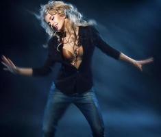 Blonde attractive woman on the dance floor photo