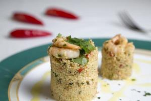 Couscous and shrimp over a dinner table