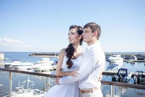 bride and groom on the background of  yacht club, young