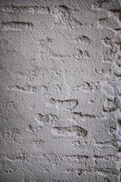 White concrete wall with black lines