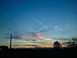 Chemtrails at sunrise photo