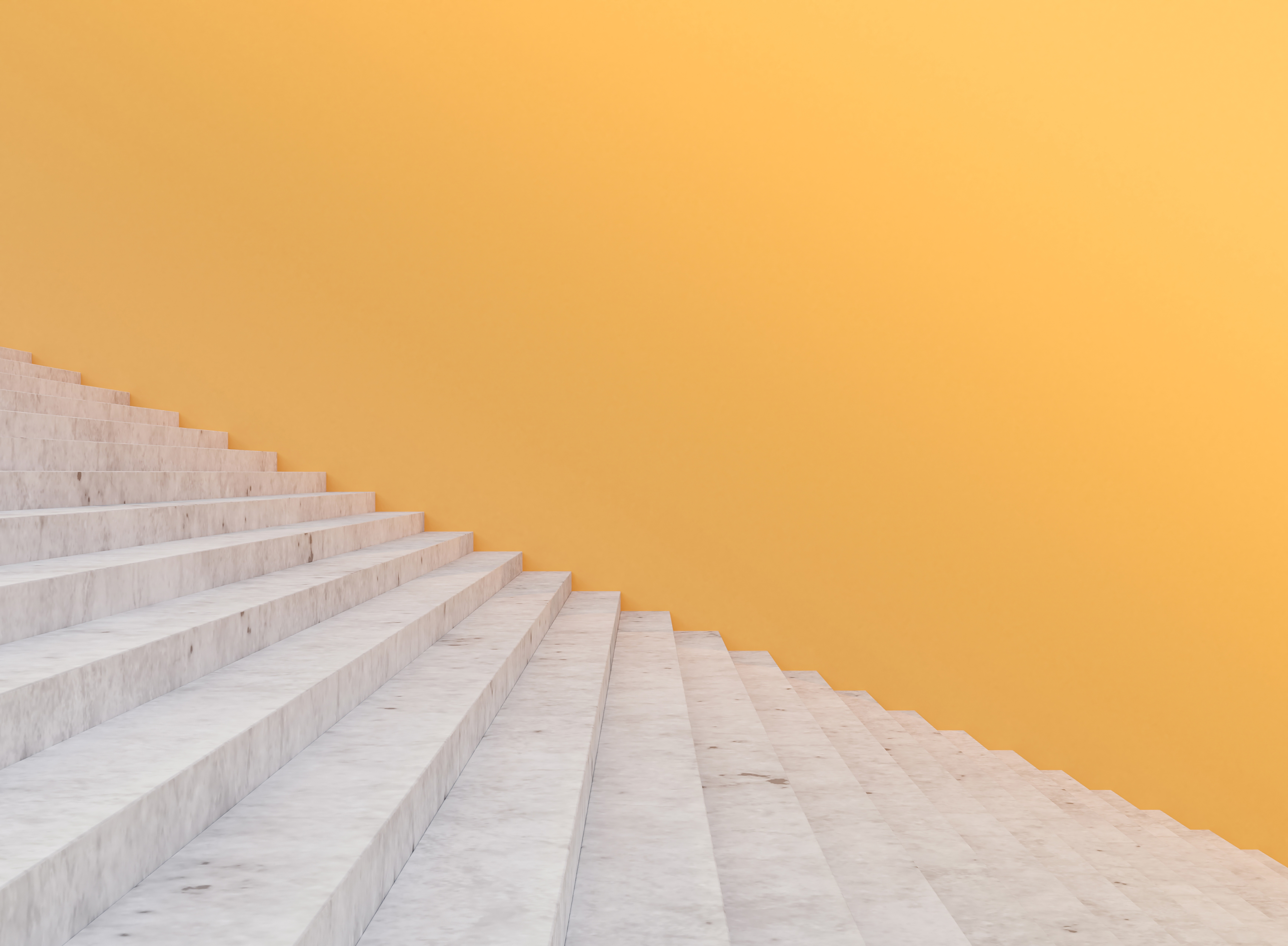 Minimal concrete staircase and yellow wall