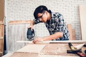 Carpenter is cutting timber