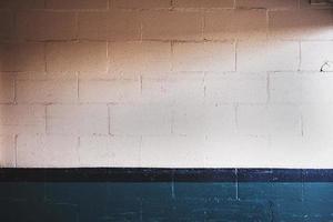 White brick wall in shadows