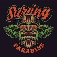 Tiki mask with foliage and surfing paradise lettering vector