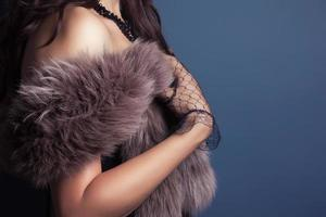 woman wearing corset and fur in retro style photo