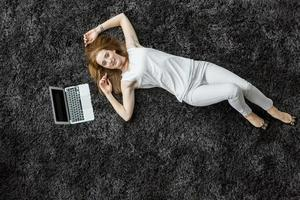 Woman laying on the carpet photo