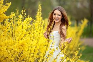 Young bride with yellow flowers. Laughs