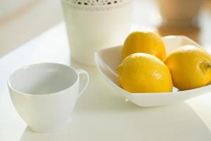 Close up of cup and lemons