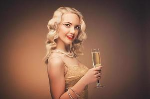 Vintage portrait of a girl in gold dress photo