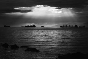 Grayscale of ships on water