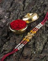 A Rakhi with rice grains and Kumkum