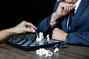Businessman and businesswoman playing chess  photo