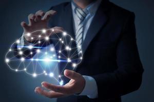Businessman holding digital brain