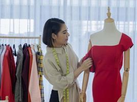 Fashion designer creating a dress