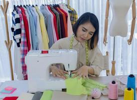 Seamstress sewing fabric photo