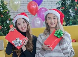 Two women holding Christmas presents photo