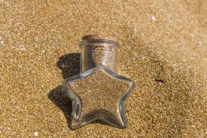 Glass container full of sand photo